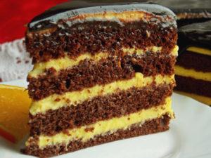 Tort cu crema de portocale si glazura de ciocolata